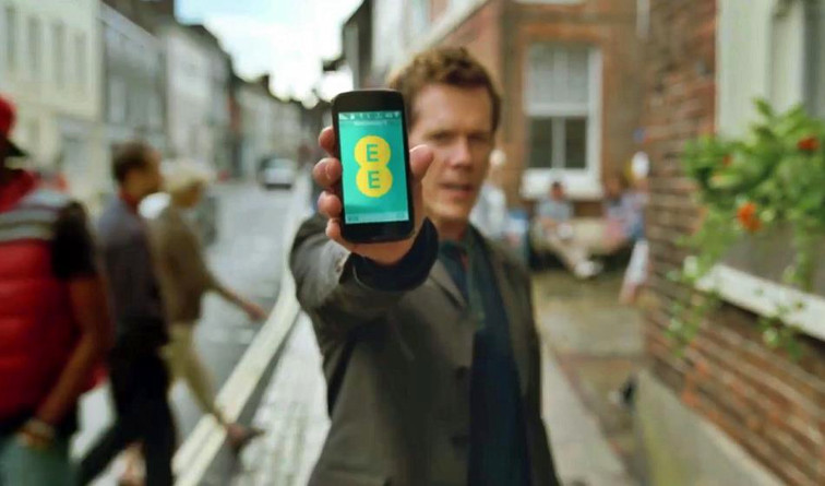 EE £2.7m fine - Kevin Bacon holds EE phone