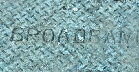 photo of a manhole cover with the word broadband