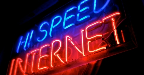 a photo of a neon sign reading high speed internet