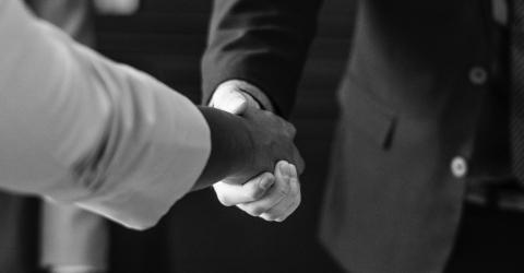grayscale photo of a handshake