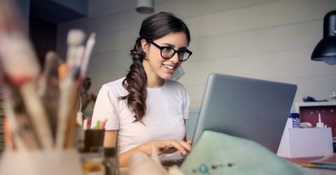 Woman happy on computer