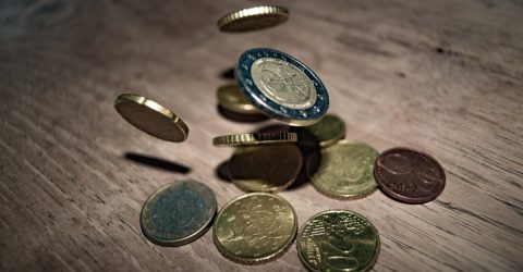 Euro coins on a wooden table