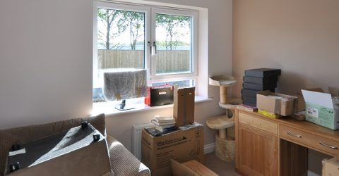 moving house belongings in packing boxes