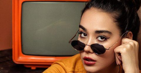 woman in sunglasses with retro tv