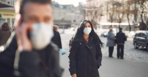 People on the street wearing surgical masks because of coronavirus