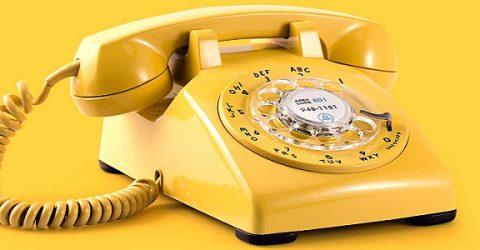 yellow rotary landline telephone bakelite