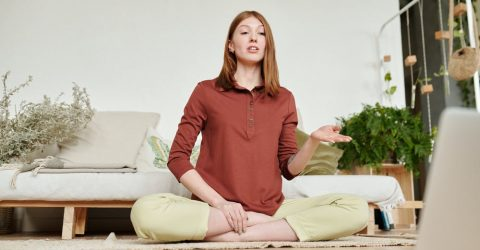 a woman teaching yoga online