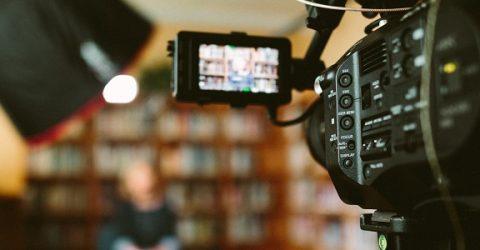 a tv camera filming a scene