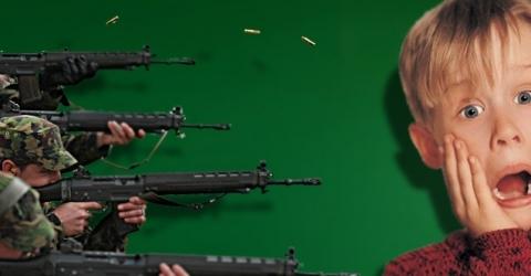 guns pointed at mcauley culkin